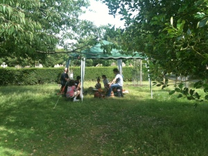 A drumming workshop in the community orchard